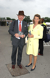 MR & MRS BARRY HILLS he is the race horse trainer at the King George VI and The Queen Elizabeth Diamond Stakes sponsored by De Beers held at Newbury Racecourse, Berkshie on 23rd July 2005.<br />