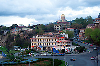 view of Europe Square with the Holy Trinity church on background. Picture taken from Meteki Church of Asumption in the evening in Tbilisi Georgia
