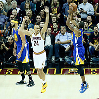 07 June 2017: Golden State Warriors forward Andre Iguodala (9) takes a jump shot over Cleveland Cavaliers forward Richard Jefferson (24) during the Golden State Warriors 118-113 victory over the Cleveland Cavaliers, in game 3 of the 2017 NBA Finals, at  the Quicken Loans Arena, Cleveland, Ohio, USA.