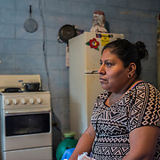 "Andre is a ""bordadora"", a talented seamstress who works from home for the clothes factory Confetti, for which she sews manually extreme difficult clothes' decorations. Once a week she and other ""bordadoras"" go to a small house inside her village, Las Casitas, 30 km from San Salvador, where the owner of the factory collect their work and pays them. She gets paid around 2.85 US dollars for piece. It takes her a whole day to sew one piece. She has to deliver around 10, 15 pieces per week, so she basically works no-stop all week long with lots of stress and pression as the owner takes her out 20 cents of dollar for every piece that she is not able to deliver on time. Usually, the clothes they work on, are then sold in the United States for around 200 US dollar in the upscale clothes shops of the 5th Avenue in New York"