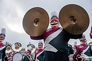 The marching band plays in the tailgate party area of the parking lot at Washington-Grizzly Stadium on the campus of the University of Montana in Missoula, Montana, on Saturday, November 1, 2014. Pictured is percussionist Conner Menahan, 21, of Colstrip, MT.