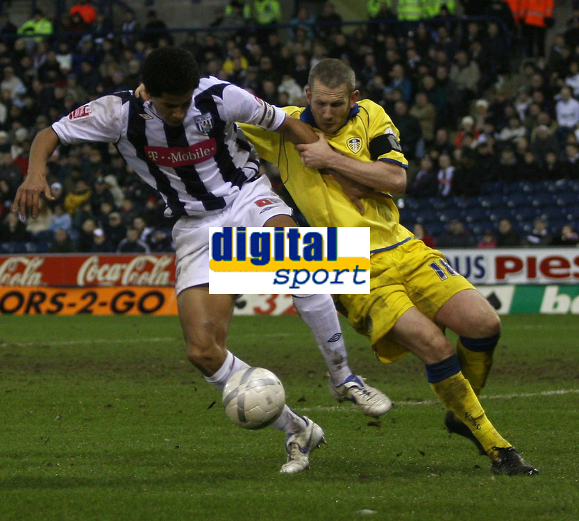 Photo: Mark Stephenson.<br />West Bromwich Albion v Leeds United. The FA Cup. 06/01/2007.<br />West Brom's Curtis Davies (L) holds off Leeds Eddie Lewis.