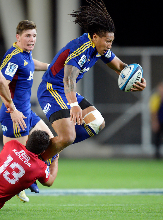 Highlanders Ma'a Nonu attempts to skip the tackle of Reds Anthony Faingaa in the Super Rugby match at Forsyth Barr Stadium, Dunedin, New Zealand, Friday, March 29, 2013. Credit:SNPA / Ross Setford