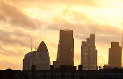 © Licensed to London News Pictures . 30/12/2013. London, UK. A sunset over the city of London seen from Hackney, east London, today 30th December 2013. Photo credit : Isabel Infantes /LNP