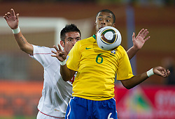 Mauricio Isla of Chile vs Michel Bastos of Brazil during the 2010 FIFA World Cup South Africa Round of Sixteen match between Brazil and Chile at Ellis Park Stadium on June 28, 2010 in Johannesburg, South Africa. Brazil defeated Mexico 3-0 and qualified for quarterfinals.  (Photo by Vid Ponikvar / Sportida)