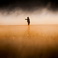 Ryan Brennecke<br /> (406) 546-3553<br /> <br /> An angler makes a cast to a cruising trout as the sun begins to rise during a foggy morning at Davis Lake, Oregon.