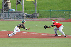 29 July 2016: Justin Fletcher gets caught in a pick off throw to Jose Barraza after he tauts the pitcher with a fake move to second during a Frontier League Baseball game between the Lake Erie Crushers and the Normal CornBelters at Corn Crib Stadium on the campus of Heartland Community College in Normal Illinois