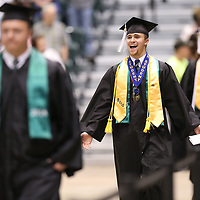 Mooreville High School's Valedictorian Mitchell Tharp begins to celebrate graduatin as he enters the BancorpSouth Arena Saturday afternoon.