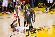 Golden State Warriors forward Draymond Green (23) walks over Houston Rockets center Clint Capela (15) during Game 4 of the Western Conference Finals at Oracle Arena in Oakland, Calif., on May 22, 2018. (Stan Olszewski/Special to S.F. Examiner)