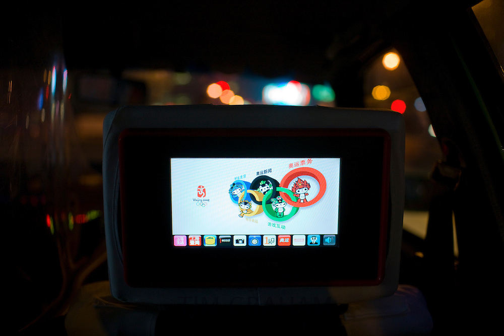 Beijing 2008 Olympics advertisement with mascots on passenger video screen in taxicab, Shanghai, China