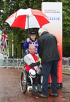Leon Daniels Managing Director Surface Transport at Transport for London greets Heinz Freil (SUI) the third placed rider at the medal ceremony for the Mens Handcycle Classic at Prudential RideLondon, the world's greatest festival of cycling, involving 70,000+ cyclists – from Olympic champions to a free family fun ride - riding in five events over closed roads in London and Surrey over the weekend of 9th and 10th August. <br /> <br /> Photo: Neil Turner for Prudential Ride London<br /> <br /> Sunday 10th August 2014<br /> <br /> See www.PrudentialRideLondon.co.uk for more.<br /> <br /> For further information: Penny Dain 07799 170433<br /> pennyd@ridelondon.co.uk