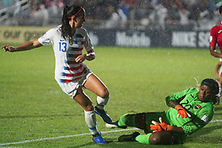 October 11, 2018 - Cary, North Carolina, United States - CARY, NC - OCTOBER 10: .L-R Alex Morgan of USA and Saundra Baron of Trinidad and Tobago during CONCACAF Women's Championship Group A match between Trinidad and Tobago against USA at Sahlen's Stadium, Cary, North Carolina. on October 10, 2018  (Credit Image: © Action Foto Sport/NurPhoto via ZUMA Press)
