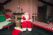 A comical feature showing the diverse and wide variety of Santa Clause's one can find in and around London. Father Christmas seems to have a wide range of appearances and different types of grottos from the elaborate Hamley's Toy Store to a garden shed in a Chobham garden centre. <br /> Pictured - Santa Clause and his grotto at Winter Wonderland, London.<br /> Credit: Rick Findler / Story Picture Agency