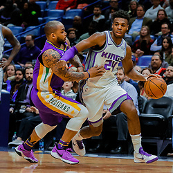Jan 30, 2018; New Orleans, LA, USA; Sacramento Kings guard Buddy Hield (24) drives past New Orleans Pelicans guard Jameer Nelson (14) during the second quarter at the Smoothie King Center. Mandatory Credit: Derick E. Hingle-USA TODAY Sports