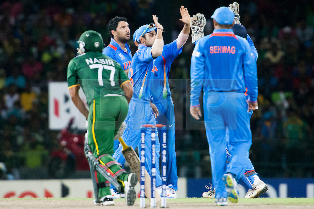 © Licensed to London News Pictures. 30/09/2012. Indian players celebrate after getting the wicket of Nasir Jamshed during the T20 Cricket World super 8's match between India Vs Pakistan at the R Premadasa International Cricket Stadium, Colombo. Photo credit : Asanka Brendon Ratnayake/LNP