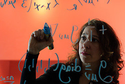 UK ENGLAND OXFORD 3DEC03 - Research Fellow in Astrophysics at Oxford University, Janna Levin writes a mathematical model on the glass wall of her office. Last year she published her first book titled 'How the Universe Got Its Spots' - Diary of a Finite Time in a Finite Space - in which she argues her mathematical model of a finite universe...jre/Photo by Jiri Rezac..© Jiri Rezac 2003..Contact: +44 (0) 7050 110 417.Mobile:   +44 (0) 7801 337 683.Office:    +44 (0) 20 8968 9635..Email:   jiri@jirirezac.com.Web:     www.jirirezac.com