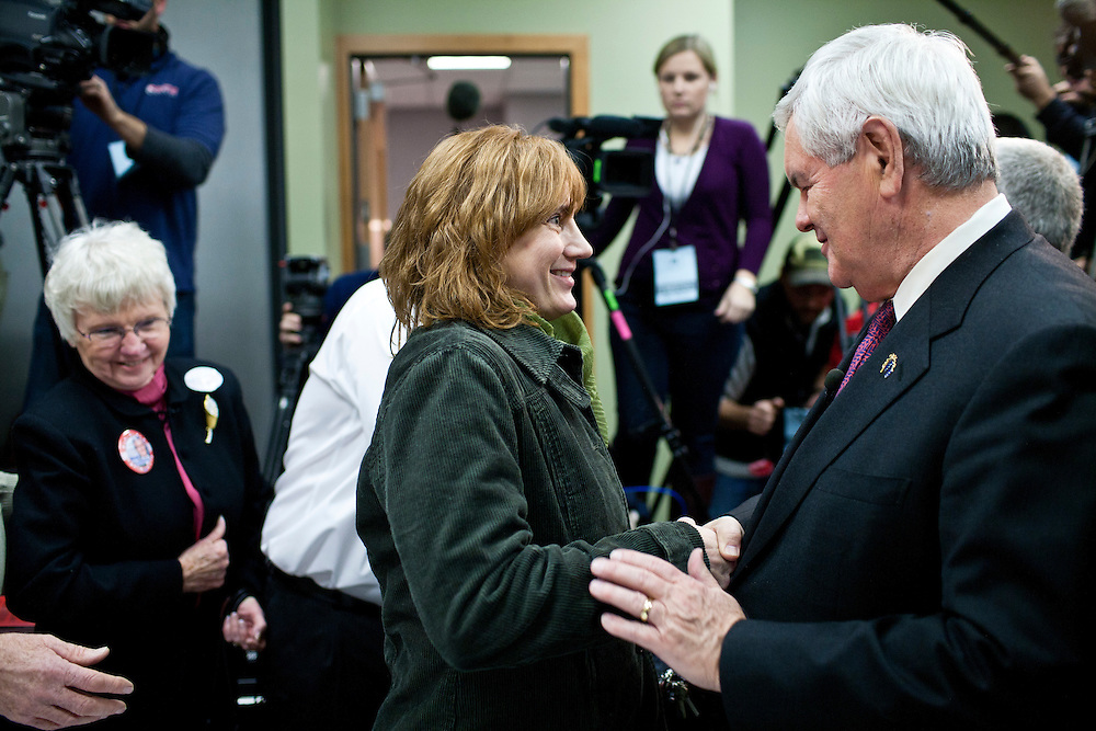Republican presidential candidate Newt Gingrich greets a supporter at the Polk County Republican Party's Robb Kelley Victory Club dinner on Thursday, December 1, 2011 in Johnston, IA.