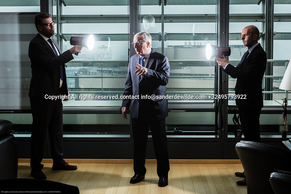 Brussels Belgium April 12 2018 President of ther European Commission Jean-Claude Juncker portrayed at his office on the topfloor of the Berlaymont building.two journalists of Dutch daily TRouw aiming lights at him. Christoph Schmidt left, Stevo right of mr Juncker.