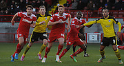 Matt Harrold, Joe Walsh and Izale McLeod await the corner during the Sky Bet League 1 match between Crawley Town and Colchester United at Broadfield Stadium, Crawley, England on 28 December 2014. Photo by Michael Hulf.