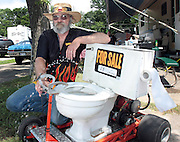 David W. Smith/ Daily News<br /> Tom Cunningham from Dayton OH, shows off the motorized toilet he has for sale during the Hot Rod Reunion Thursday at Beech Bend Campground.