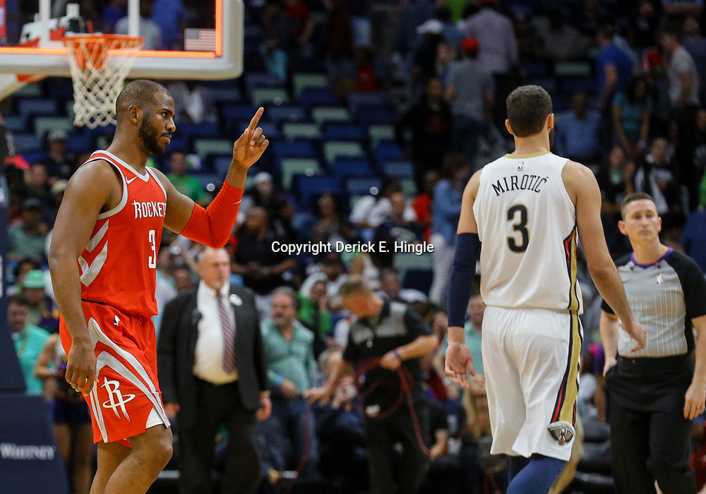 Mar 17, 2018; New Orleans, LA, USA; Houston Rockets guard Chris Paul (3) reacts after a win as New Orleans Pelicans forward Nikola Mirotic (3) leaves the court following a game at the Smoothie King Center. The Rockets defeated the Pelicans 107-101. Mandatory Credit: Derick E. Hingle-USA TODAY Sports