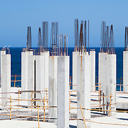 Reinforced support columns at a building construction site near the sea.<br />