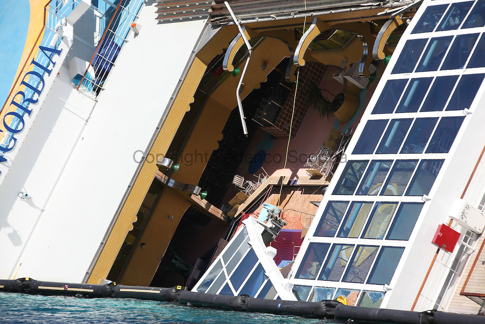 The Costa Concordia wreck, the windows on the top felt some week after the wreckage showing the inside of the ship