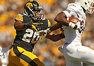 September 21 2013: Iowa Hawkeyes linebacker Christian Kirksey (20) chases Western Michigan Broncos wide receiver Corey Davis (84) during the first quarter of the NCAA football game between the Western Michigan Broncos and the Iowa Hawkeyes at Kinnick Stadium in Iowa City, Iowa on September 21, 2013. Iowa defeated Western Michigan 59-3.