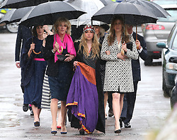 Mark Shand's 19-year-old daughter, Ayesha (19) centre,  her cousin, Katie Elliot (left) and the Duchess of Cornwall's sister Annabel Elliot arriving for Mark Shand's funeral at Holy Trinity Church, Stourpaine, Dorset, United Kingdom, Thursday, 1st May 2014. Picture by Stephen Lock / i-Images