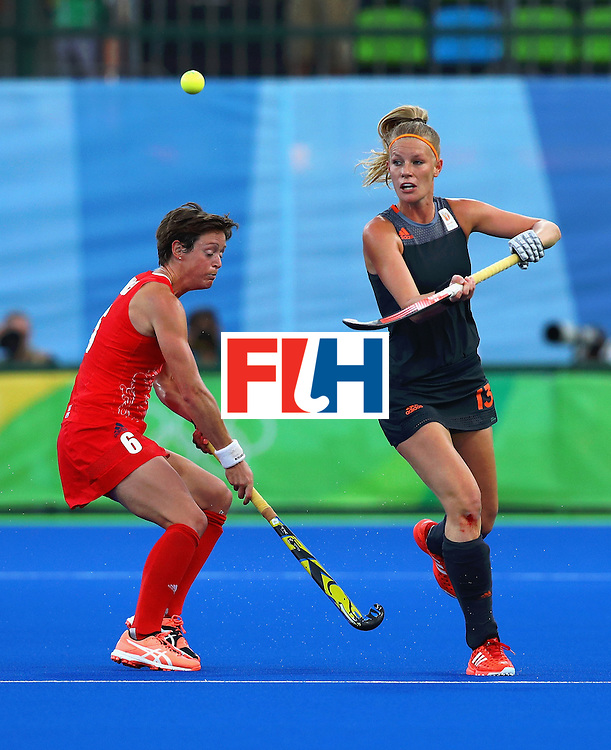 RIO DE JANEIRO, BRAZIL - AUGUST 19:  Hannah MacLeod of Great Britain and Caia van Maasakker of Netherlands action during the Women's Gold Medal Match against the Netherlands on Day 14 of the Rio 2016 Olympic Games at the Olympic Hockey Centre on August 19, 2016 in Rio de Janeiro, Brazil.  (Photo by Tom Pennington/Getty Images)