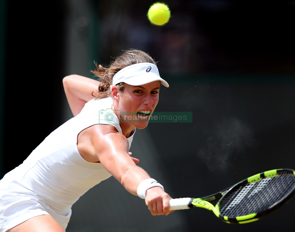 Johanna Konta in action against Caroline Garcia on day seven of the Wimbledon Championships at The All England Lawn Tennis and Croquet Club, Wimbledon.