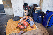 Roma 11 Luglio 2014<br /> I rom del campo rom  di Val d'Ala, al quartiere Monte Sacro, sgomberati il 9 Luglio, dalla polizia municipale di Roma, e rimasti senza  un abitazione, si sono accampati sotto alla sede del III Municipio, in attesa di una soluzione. I 39 rom, tra cui  11 minori e neonati, dormono e mangiano  per la strada, sono  assistiti dall'Associazione 21 Luglio. Mamma con un figlio di 8 mesi, e una figlia di 3 anni dormono in terra.<br /> Rome July 11, 2014 <br /> The Roma of Roma camp in Val d'Ala, the Monte Sacro district, evacuated July 9, by the municipal police of Rome,and remained without a home, they are camped under the seat of the Town Hall III, waiting for a solution. The 39 Roma, including 11 children and infants, sleep and they eat for the road, they are assisted by the association 21 July. Mom with an 8 month old son, and a 3 year old daughter, sleep on the floor