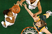 Rebecca Kielpinski of UAA tries to knock a rebound out before a UC Riverside player, left, can grab it during the second-half in the championship game of the women's Great Alaska Shootout Wednesday evening November 22, 2006 at Sullivan Arena.