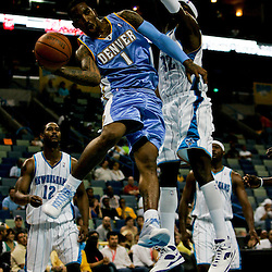 27 April 2009: Denver Nuggets guard J.R. Smith (1) passes the ball as New Orleans Hornets forward Julian Wright (32) defends during a 121-63 win by the Denver Nuggets over the New Orleans Hornets in game four of the NBA Western Conference Quarterfinals playoff game played at the New Orleans Arena in New Orleans, Louisiana.