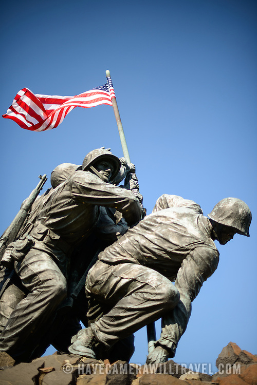 Front view of the Iwo Jima Memorial (formally the Marine Corps War Memorial) in Arlington, Virginia, next to Arlington National Cemetery. The monument was designed by Felix de Wledon and is based on an iconic Associated Press photo called the Raising the Flag on Iwo Jima by Joe Rosenthal. It was dedicated in 1954.