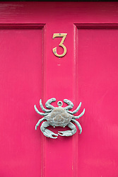 Door knocker in shape of crab on house in small fishing village on Moray coast in Scotland