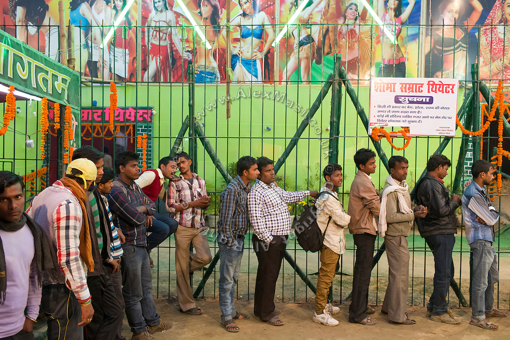 Men are queuing up  to enter one of the regular night dance shows set up during the yearly Sonepur Mela, Asia's largest cattle market, in Bihar, India.