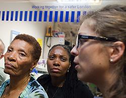 © Licensed to London News Pictures . 21/08/2012 . London , UK . Left and centre : Maria Rigg and Samantha Rigg-Davy ( mother and sister of Sean Rigg who died in police customer in August 2008 ) inside Brixton police station . Video has emerged of a man being detained in Brixton on Sunday ( 19th August ) during which it is alleged police officers stamped on the  man's head . Protesters march from Lambeth Town Hall to Brixton police station and deliver a formal complaint about the incident to the front counter . Photo credit : Joel Goodman/LNP