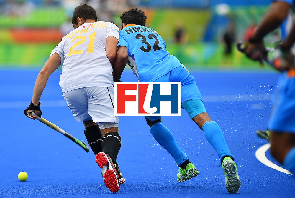 India's Chandanda Thimmaiah (R) and Canada's Matthew Sarmento vie during the mens's field hockey India vs Canada match of the Rio 2016 Olympics Games at the Olympic Hockey Centre in Rio de Janeiro on August, 12 2016. / AFP / Carl DE SOUZA        (Photo credit should read CARL DE SOUZA/AFP/Getty Images)