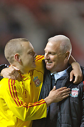 Manchester, England - Thursday, April 26, 2007: Liverpool's Youth Director Steve Heighway embraces captain Jay Spearing as they celebrate after beating Manchester United on penalties to win the FA Youth Cup for the second successive year during the FA Youth Cup Final 2nd Leg at Old Trafford. (Pic by David Rawcliffe/Propaganda)