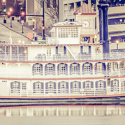 Spirit of Peoria Riverboat vintage panorama photo. The Spirit of Peoria is a paddlewheel boat in Peoria, Illinois on the Illinois River. Panoramic photo ratio is 1:3 and has a vintage retro tone.