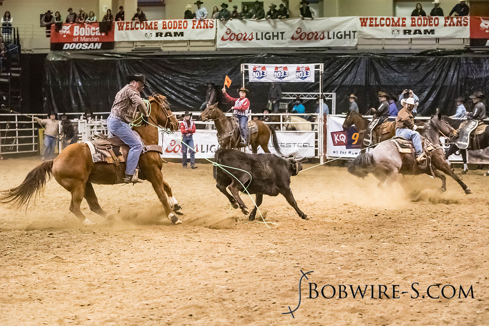 Alvaro Baeza and Beau Hutchison compete in team roping at the Bismarck Rodeo on Friday, Feb. 2, 2018. They had a 5.8-second run.