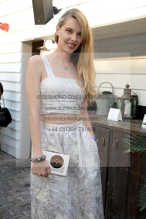 SARA BRAJOVIC attending the Warner Bros. & Esquire Summer Party held at Shoreditch House, Ebor Street, London E1 on 18th July 2013.