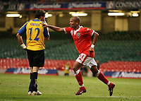 Photo: Rich Eaton.<br /> <br /> Wales v Cyprus. UEFA European Championships 2008 Qualifying. 11/10/2006. Robert Earnshaw celebrates scoring his first half goal as Cyprus keeper Michael Morphis looks dejected