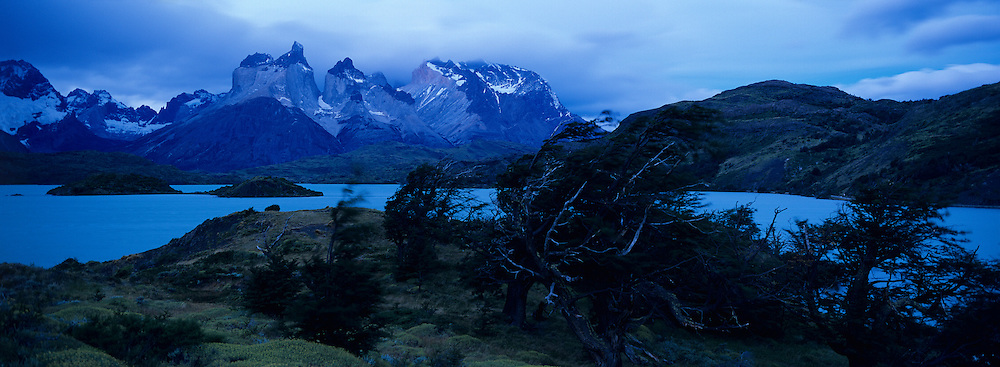 Chile, Torres del Paine National Park, Evening twilight lights clouds and Los Cuernos rock spires along Lake Pehoe in southern Patagonia