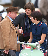 A group of Mods chatting, sat on a scooter, UK 2009