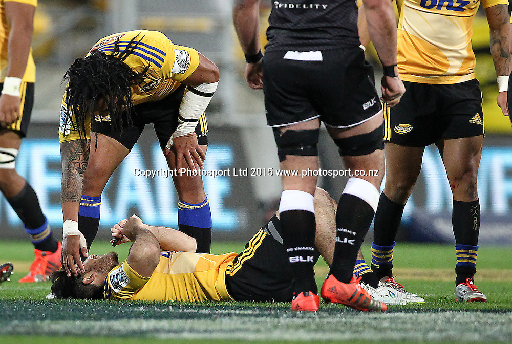 Hurricanes' Ma'a Nonu checks on Nehe Milner-Skudder after he is laid low by a high shot during the round 13 Super Rugby match. Hurricanes v Sharks. Westpac Stadium, Wellington. 9th May 2015. Copyright Photo.: Grant Down / www.photosport.co.nz