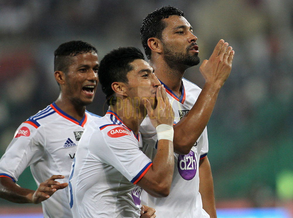 Andre Santos of FC Goa and Haroon Fakhruddin of FC Goa celebrates a goal during match 50 of the Hero Indian Super League between Chennaiyin FC and FC Goa held at the Jawaharlal Nehru Stadium, Chennai, India on the 5th December 2014.<br /> <br /> Photo by:  Vipin Pawar/ ISL/ SPORTZPICS
