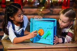 """© Licensed to London News Pictures. 13/11/2019. LONDON, UK. (L to R) Fiona (aged 10) and Gwen (aged 8) play with a Ryan's World Super Surprise Safe by Flair Leisure Products at the preview of """"DreamToys"""", the official toys and games Christmas Preview, held at St Mary's Church in Marylebone.  Recognised as the countdown to Christmas, the Toy Retailer's Association, an independent panel of leading UK toy retailers, have selected the definitive and most authoritative list of which toys will be the hottest property this Christmas.  Photo credit: Stephen Chung/LNP"""