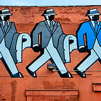 Three Strutting Men Mural on Serman's Clothing Building in Detroit, Michigan<br />